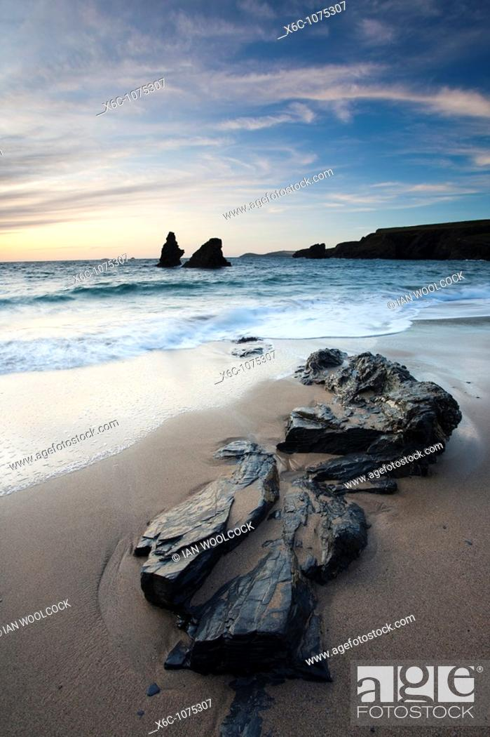 Stock Photo: Rocks on the beach at Sunset, Porthcothan Bay Cornwall England.