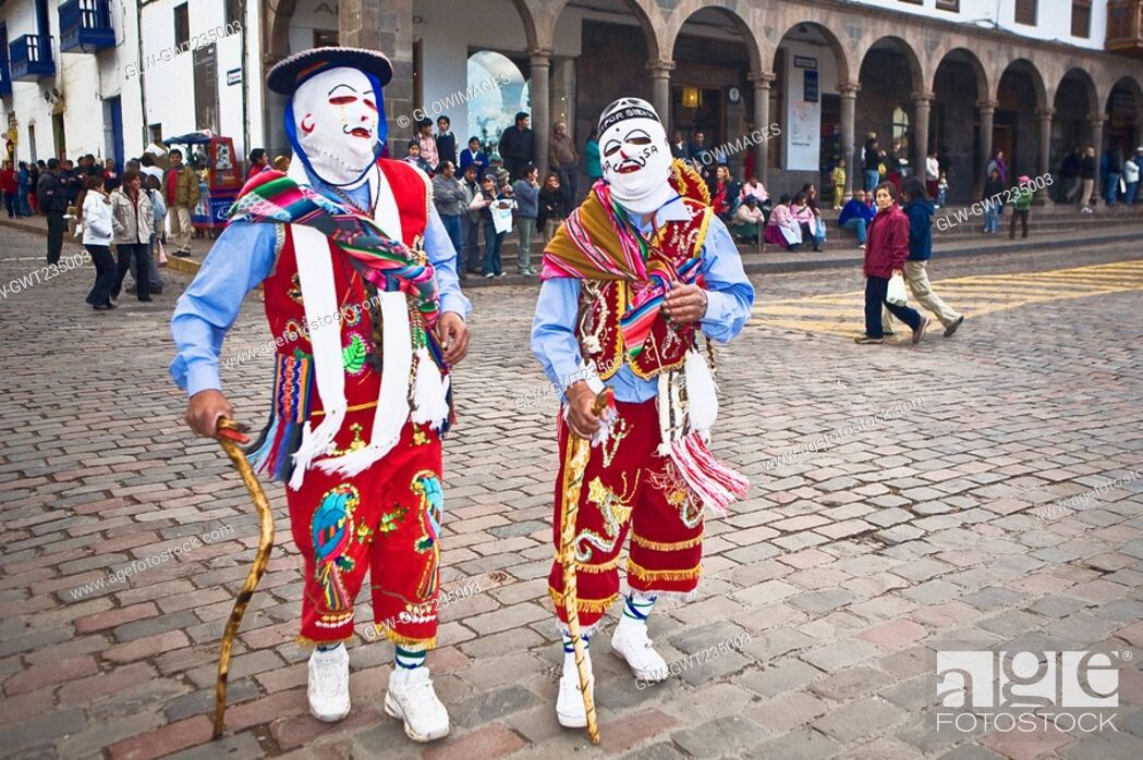 Stock Photo: Two people wearing traditional costumes in a festival, Peru.