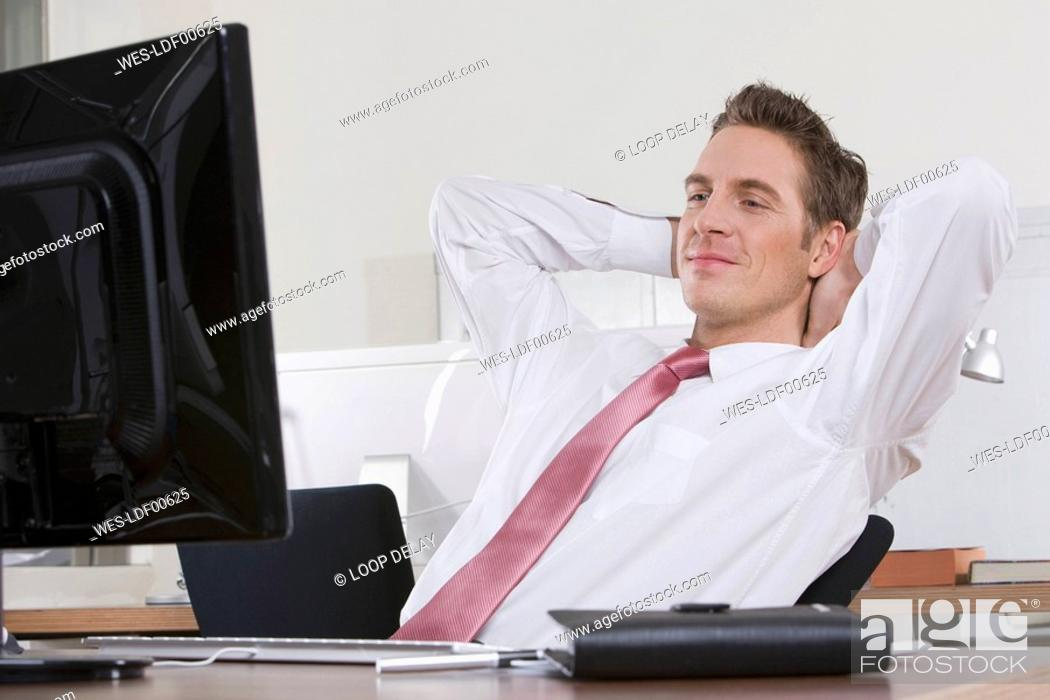 Stock Photo: Germany, Munich, business man relaxing in office.