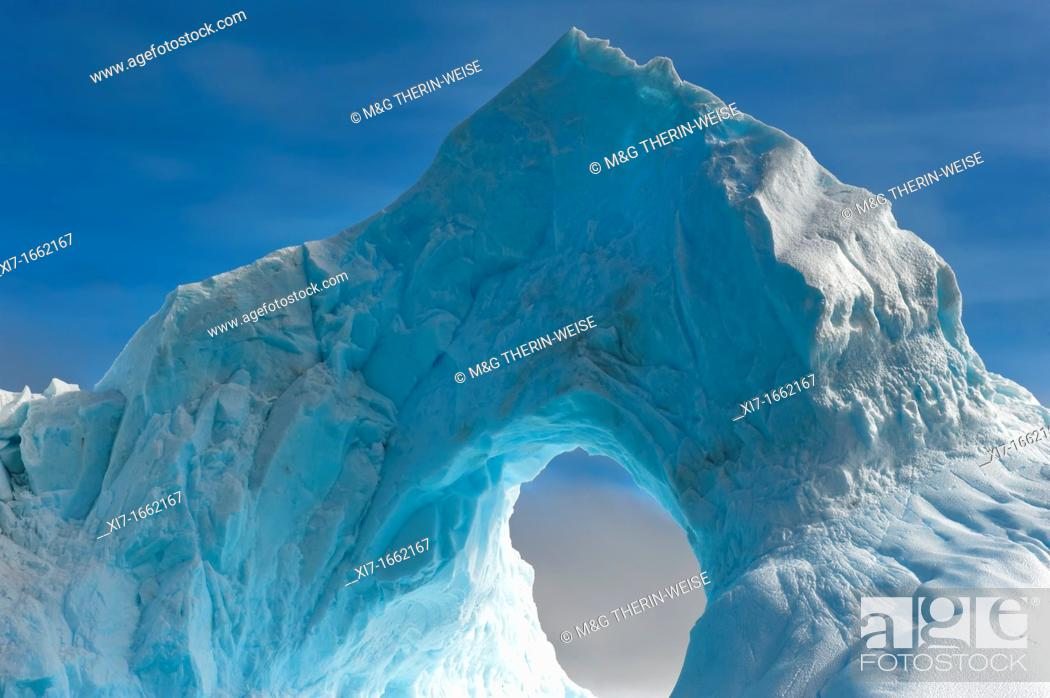 Stock Photo: Natural Arch carved in an iceberg, Antarctic Sound, Antarctic Peninsula.