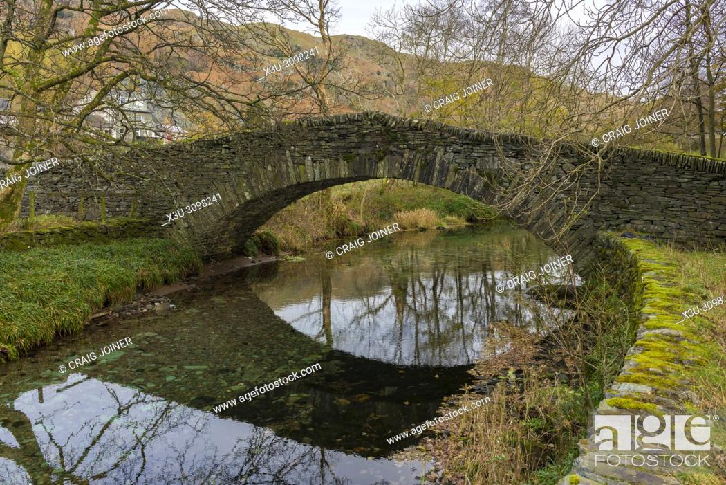 Stock Photo: Kidshall Bridge packhorse bridge over Great Langdale Beck at Chapel Stile in the Lake District National Park, Cumbria, England.
