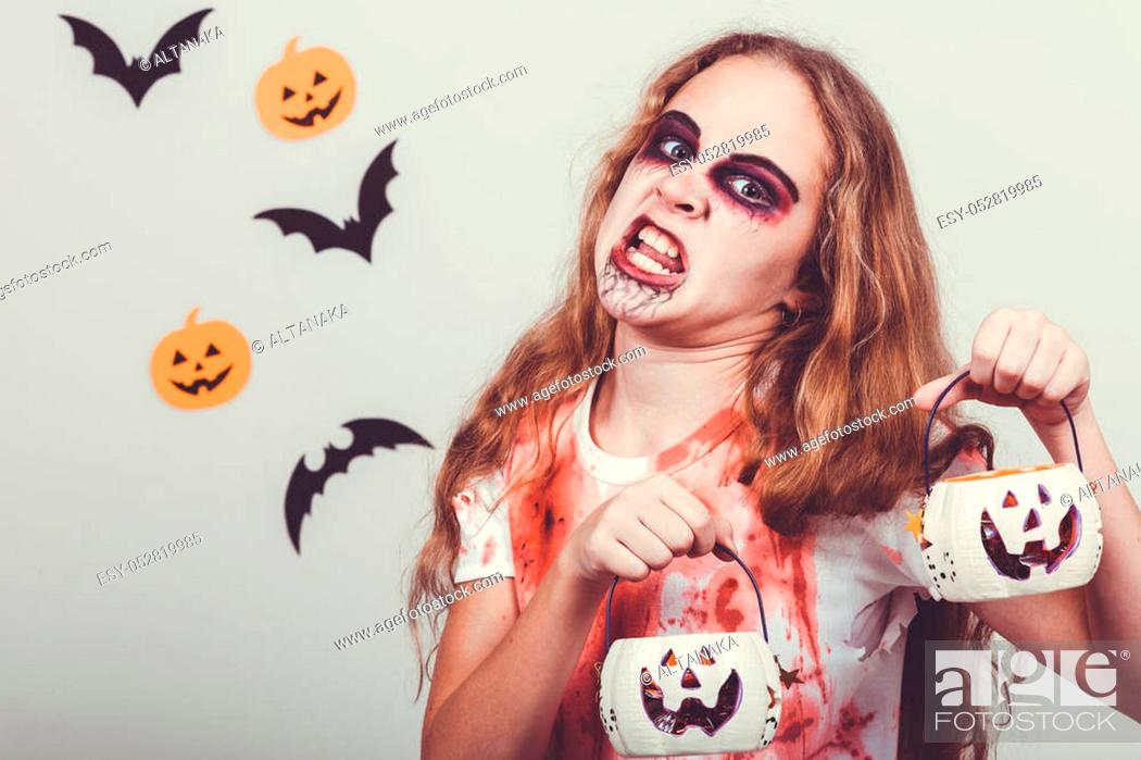 Stock Photo: Teen girl in costume zombie. Concept of death on Halloween party.