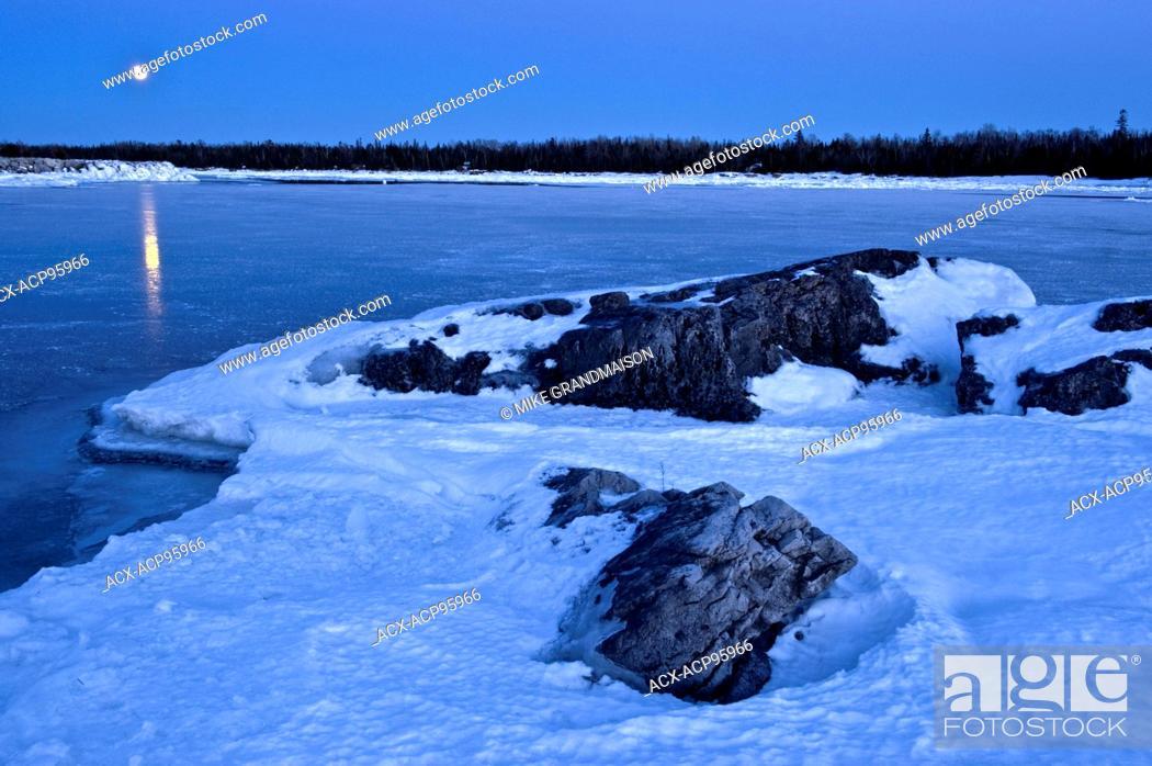Stock Photo: Full moon rising over Lake Huron. South Baymouth. Manitoulin Island Ontario Canada.