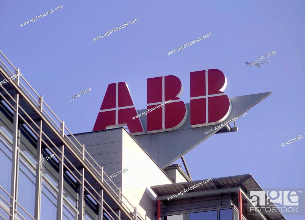 Stock Photo: Company logo on the headquarter of the ABB ( Austria ) AG in Vienna. In the sky a airplane. - WIEN, AUSTRIA, 18/09/2004.