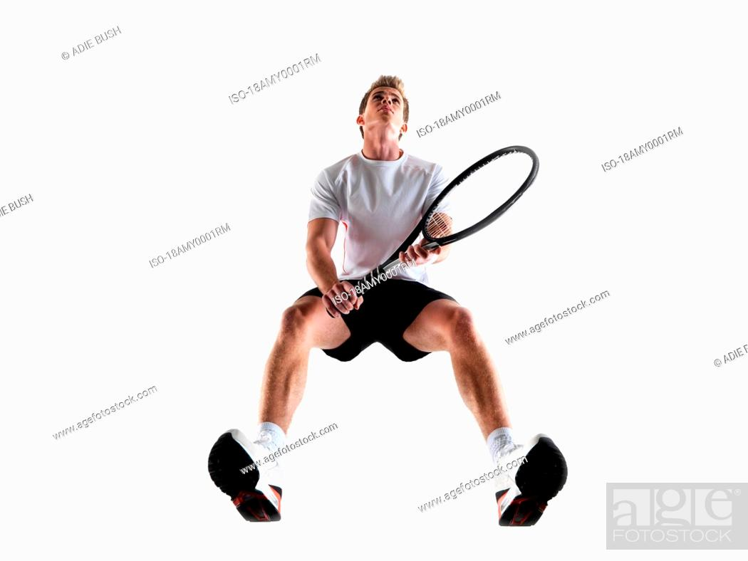 Stock Photo: Man playing tennis.