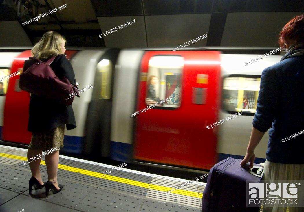 Stock Photo: TRain arriving at the platform London Bridge station, UK   London Underground Tube filmed under film permit issued by Kate Reston London Underground Film Office.