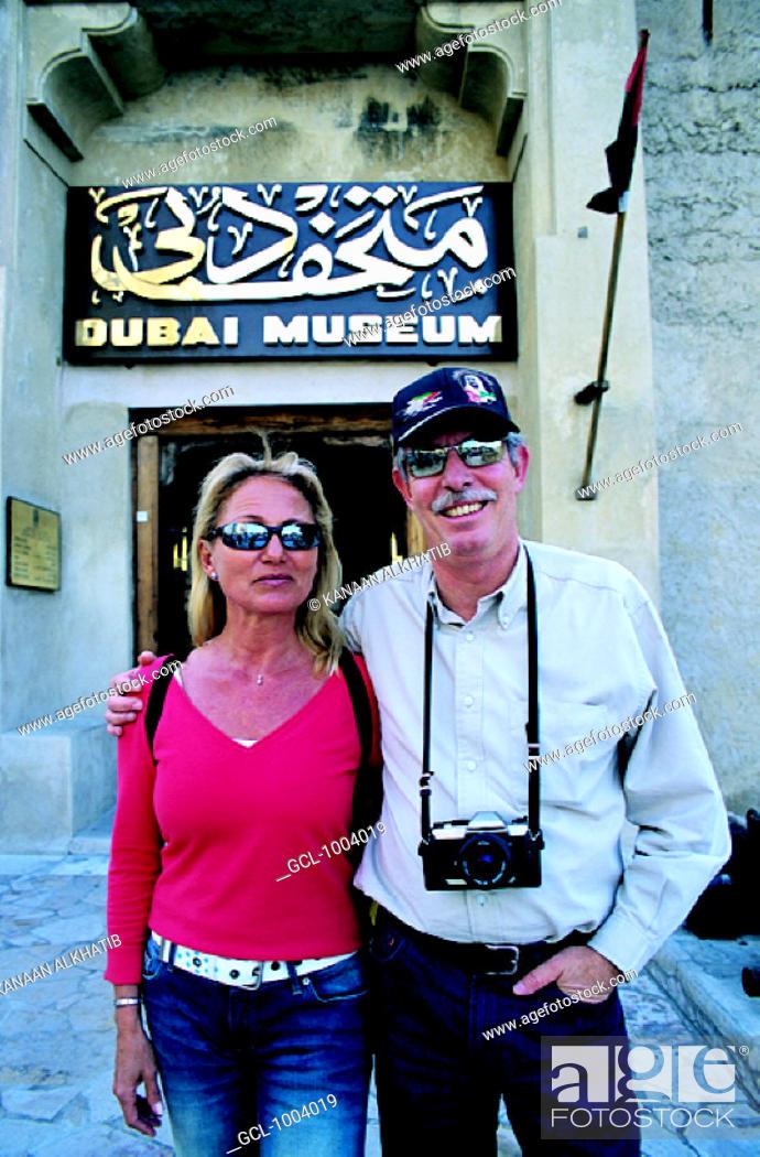 Stock Photo: Western tourist couple in front of Dubai Museum, United Arab Emirates.