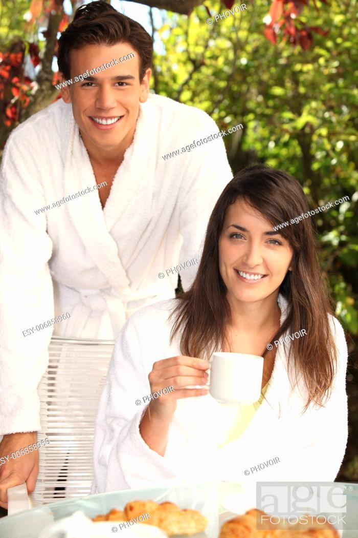 Stock Photo: A nice looking couple having breakfast outside.