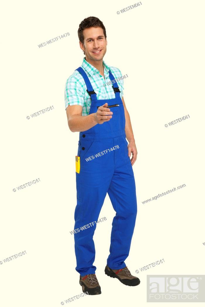 Stock Photo: Man in overall smiling, portrait.