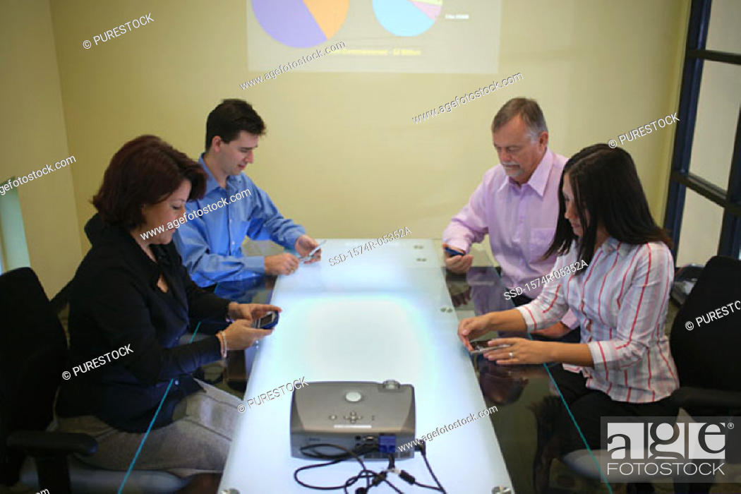 Stock Photo: Side profile of a group of business executives sitting in a conference room.