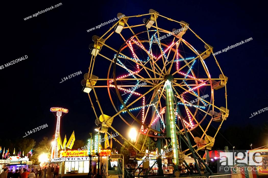Stock Photo: Ferris wheel at a carnival at night during a festival.