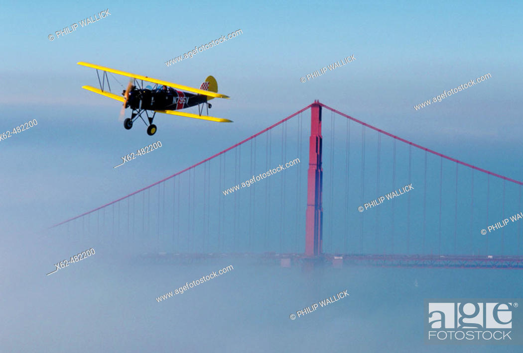 Stock Photo: Biplan and Golden Gate bridge, San Francisco, California, USA.
