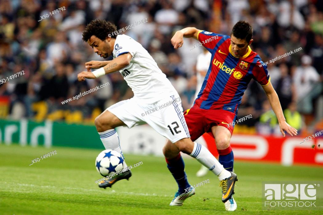 Stock Photo: Marcelo pursued by Villa, UEFA Champions League Semifinals game between Real Madrid and FC Barcelona, Bernabeu Stadiumn, Madrid, Spain.