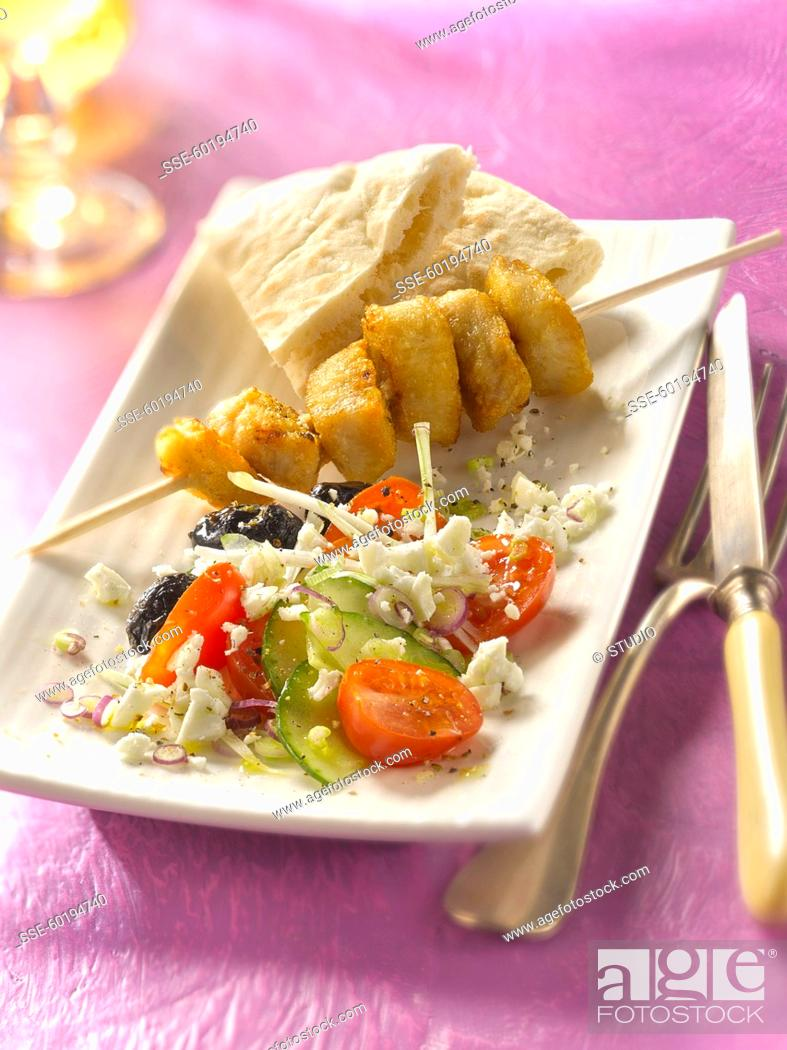 Stock Photo: Grilled chicken brochette , Greek salad and pitta.