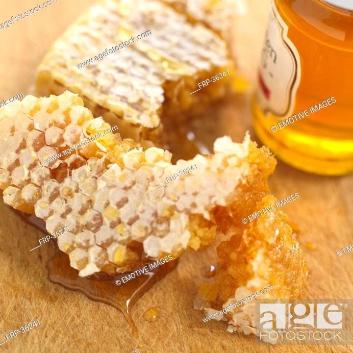 Stock Photo: Honeycomb and jar of honey.
