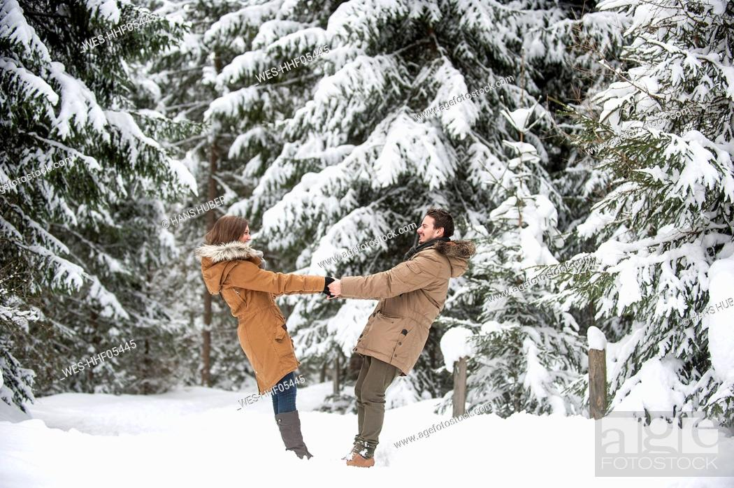 Stock Photo: Happy couple walking in winter forest.