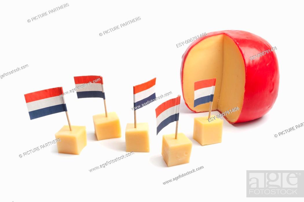 Stock Photo: Dutch Edam cheese blocks with the Dutch flag.