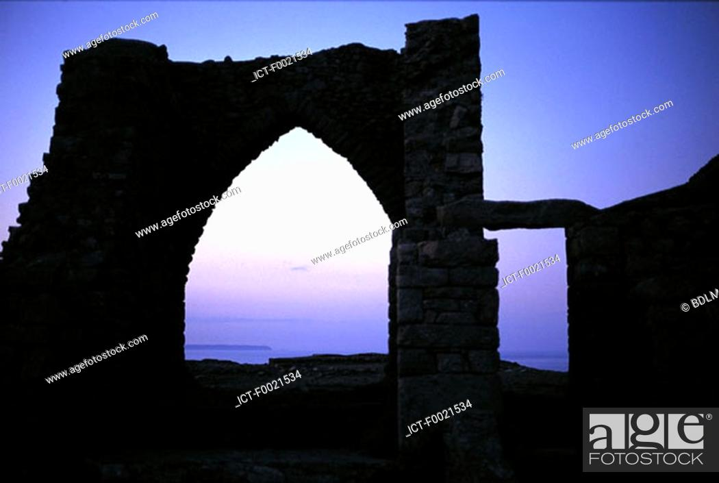 Stock Photo: Channel Islands, Jersey, Gronez Castle at dusk.