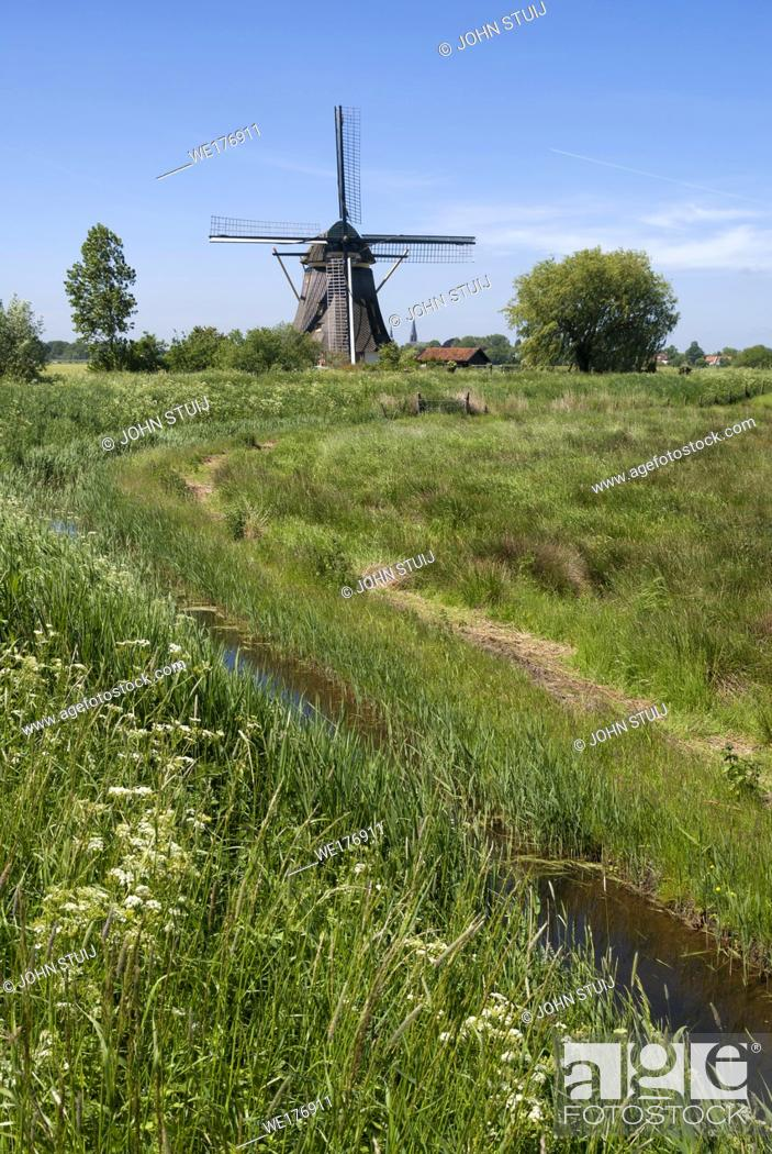 Stock Photo: Windmill the Oostzijdse Molen on the river Gein near the Dutch village Abcoude.
