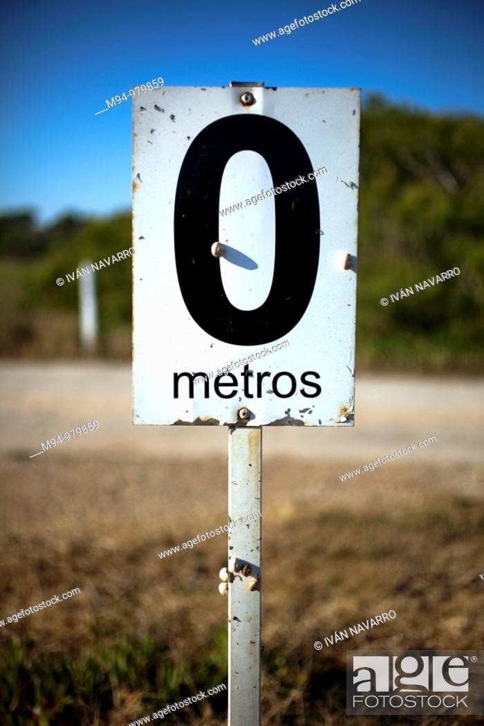 Stock Photo: Distance sign in a golf course.