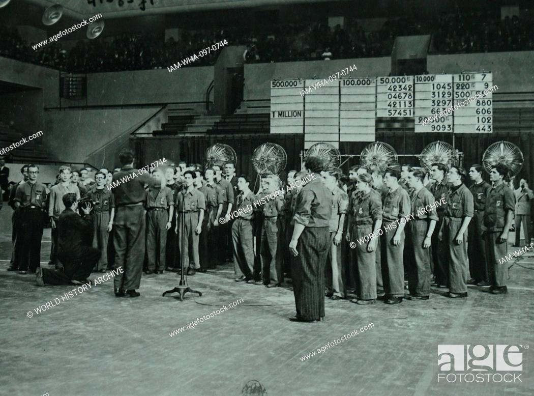 Photograph of a chorus broadcasting a song during the radio