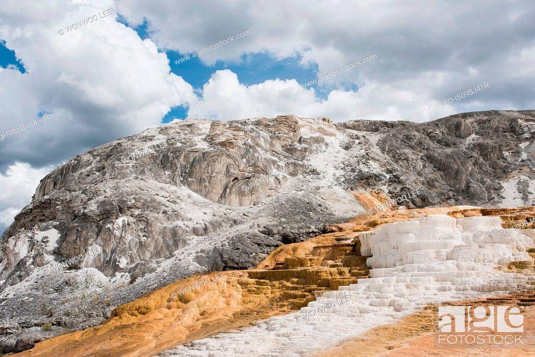 Stock Photo: White mineral terraces on mountainside, Yellowstone National Park, Wyoming, USA.