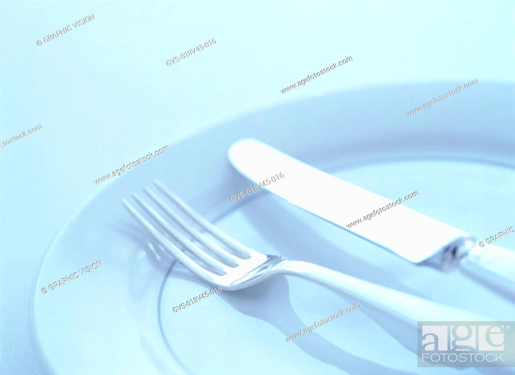 Stock Photo: los Up of Knif Fork and Plate.