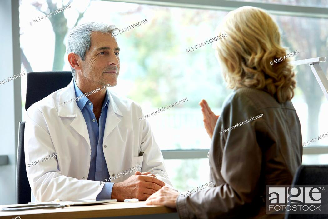 Stock Photo: Doctor consulting patient in clinic.
