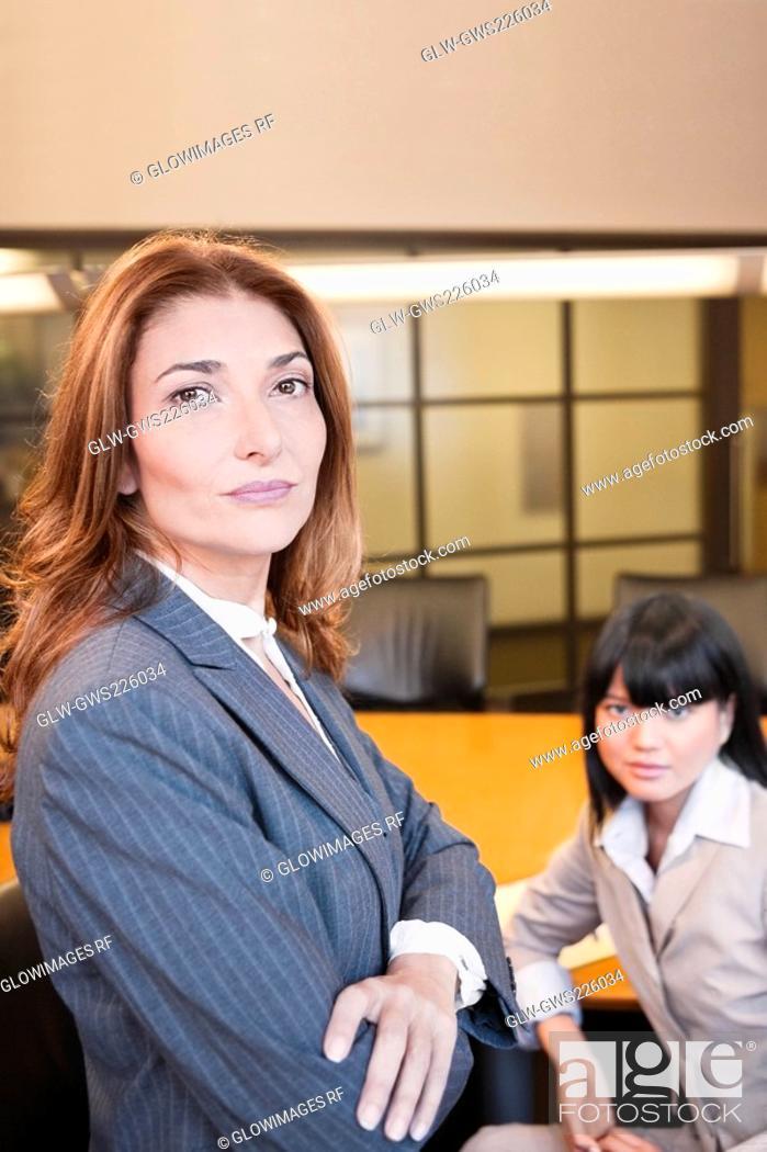 Stock Photo: Portrait of a two businesswomen in a board room.