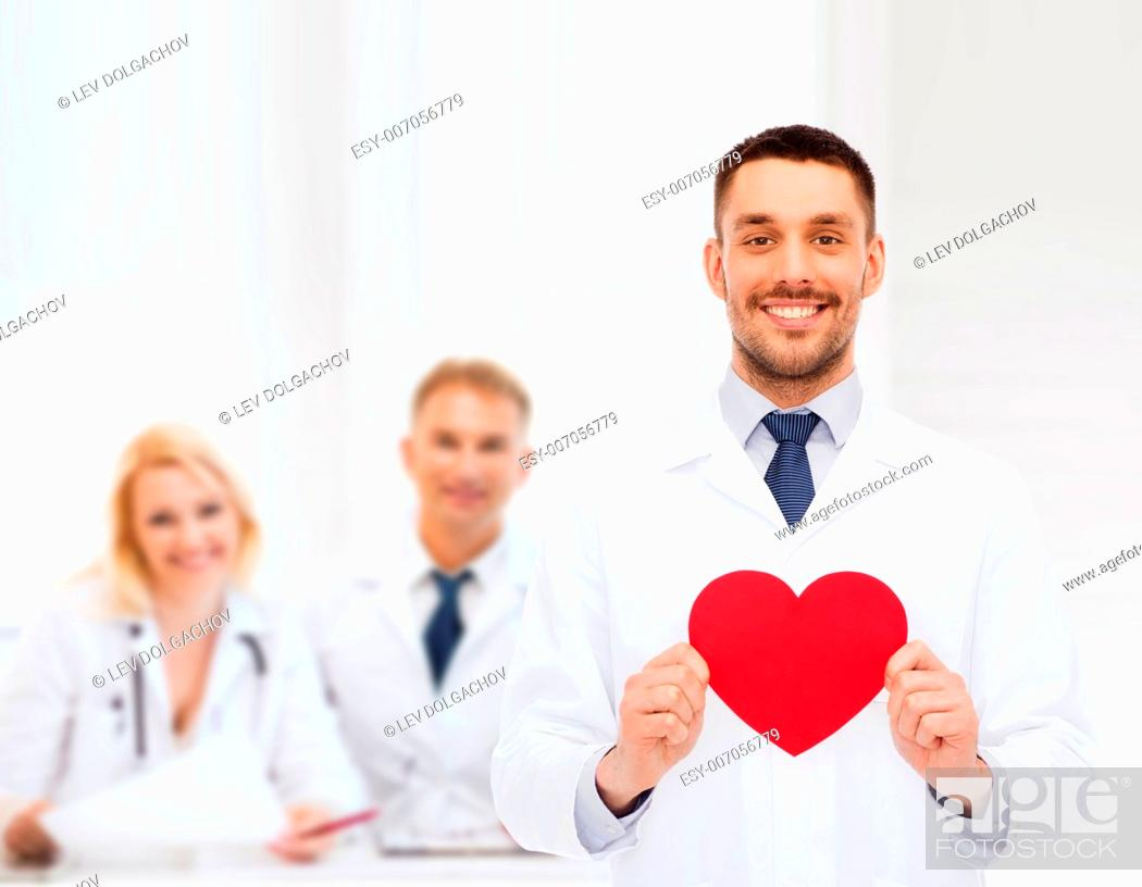 Stock Photo: medicine, profession, and healthcare concept - smiling male doctor with red heart.