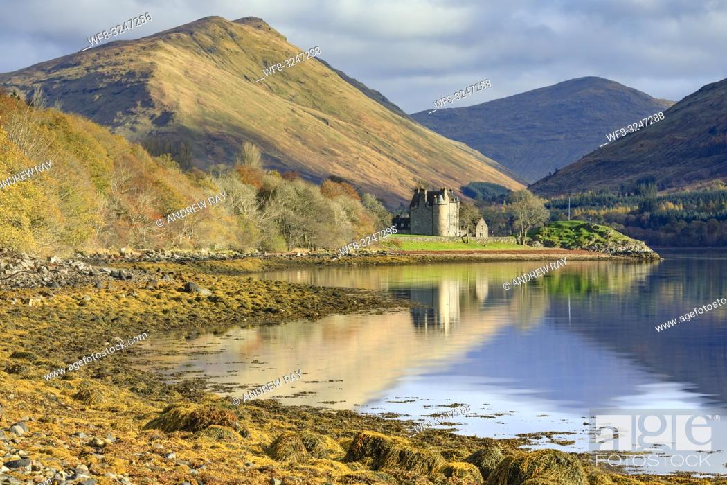 Stock Photo: Dunderave Castle in Argyll and Bute, Scotland, reflected in Loch Fyne on an afternoon in late October.