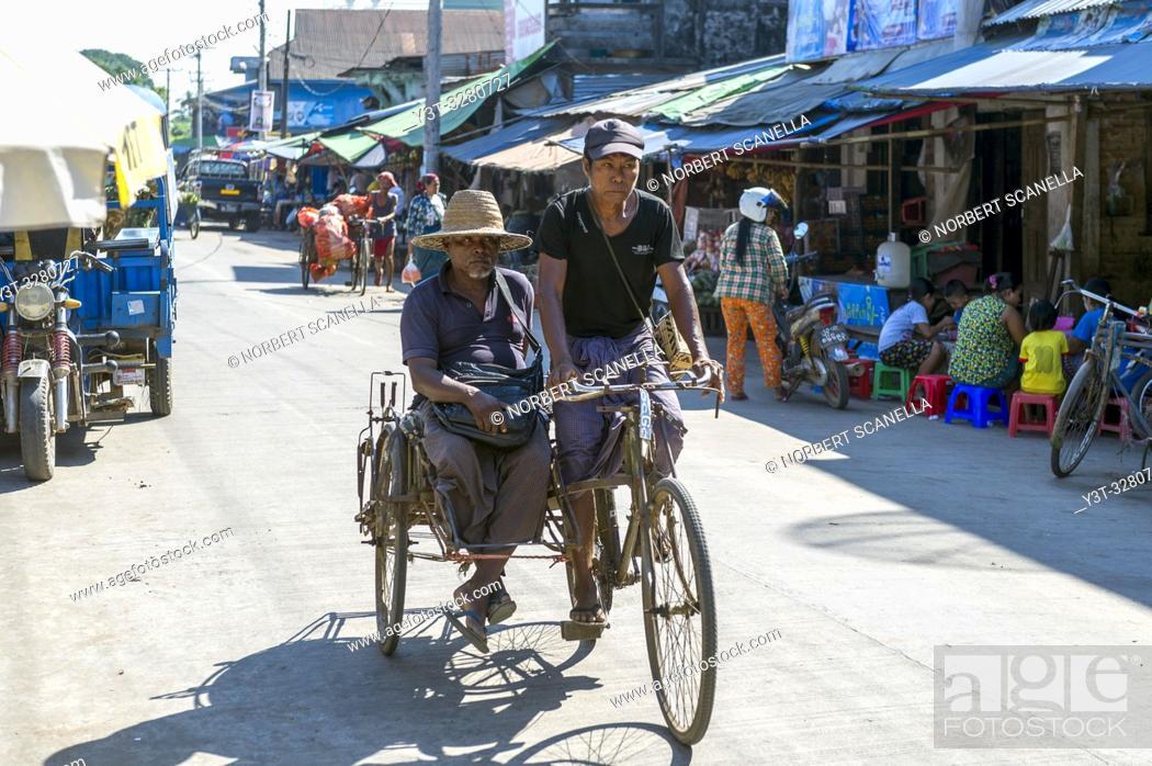 Stock Photo: Myanmar (formerly Burma). Kayin State (Karen State). Hpa An. Couple driving a rickshaw.