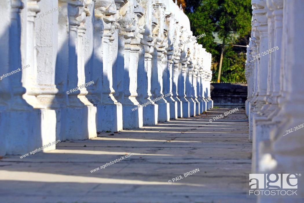 White shrines containing the world's largest book at Kuthodaw Pagoda