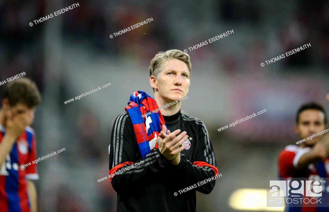 Munich's Bastian Schweinsteiger reacts during the Champions