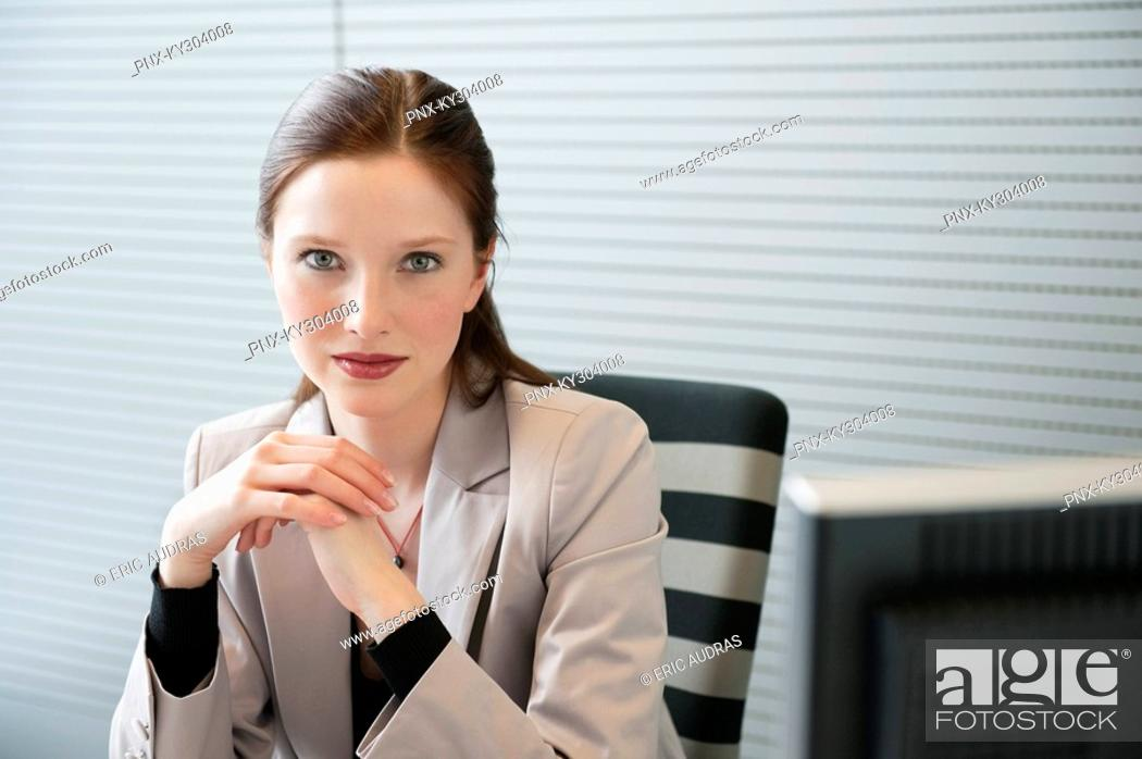 Stock Photo: Businesswoman sitting in an office.