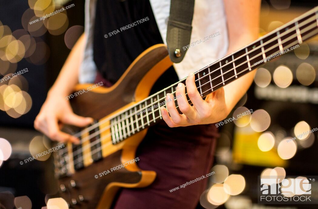 Stock Photo: close up of musician with guitar at music studio.