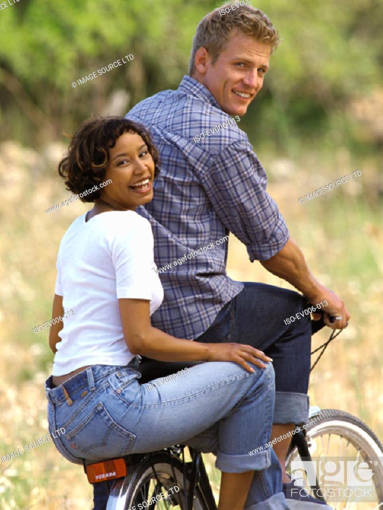 Stock Photo: Couple on bicycle.