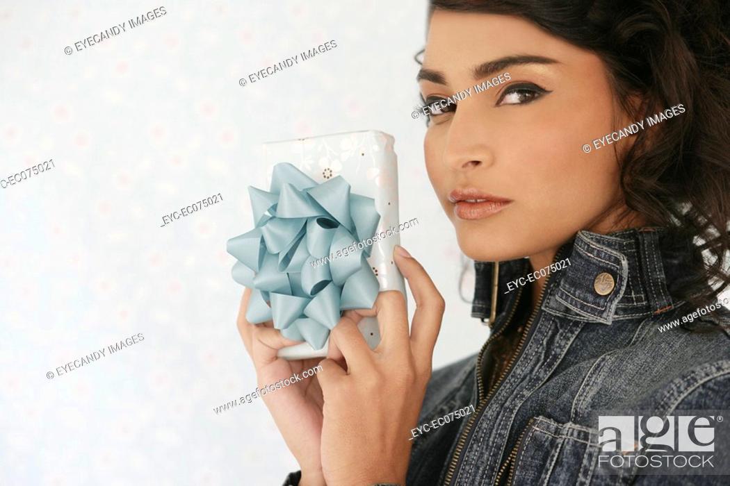 Stock Photo: Hispanic woman holding gift.
