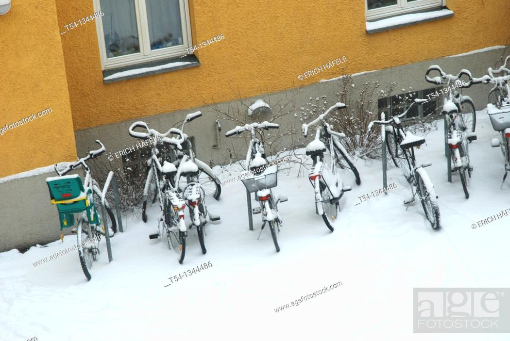 Stock Photo: Fresh snow lies on parked bicycles.