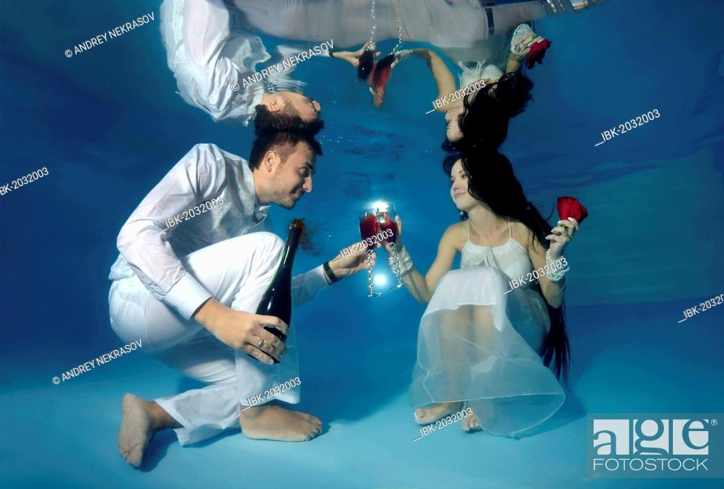 Stock Photo: Bride and groom, underwater wedding in a pool.
