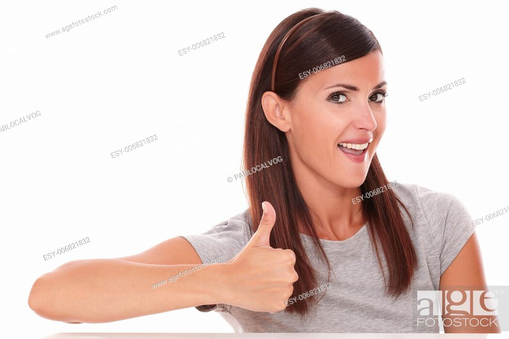 Stock Photo: Front view portrait of cute female with ok sign looking at you on isolated white background.