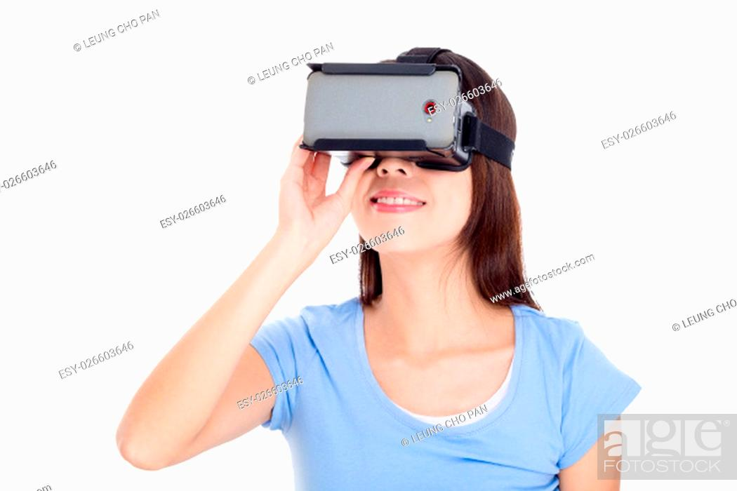 Stock Photo: Woman looking though virtual reality goggle.