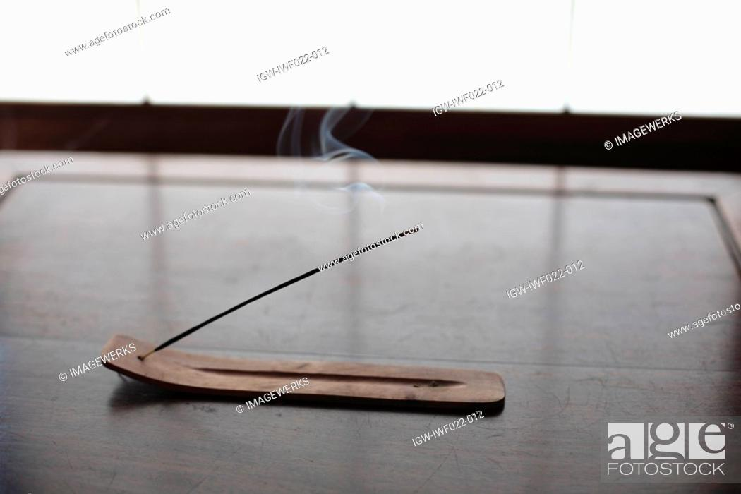 Stock Photo: Close-up of an incense stick on a stand.