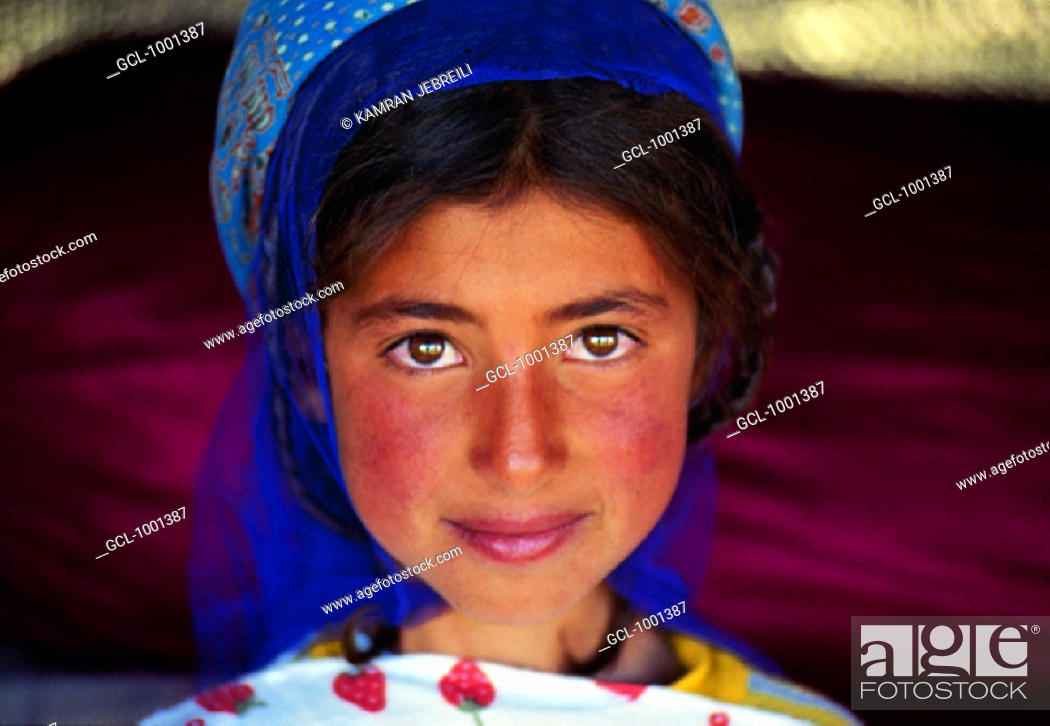 Stock Photo: Smiling Iranian girl wearing a scarf.