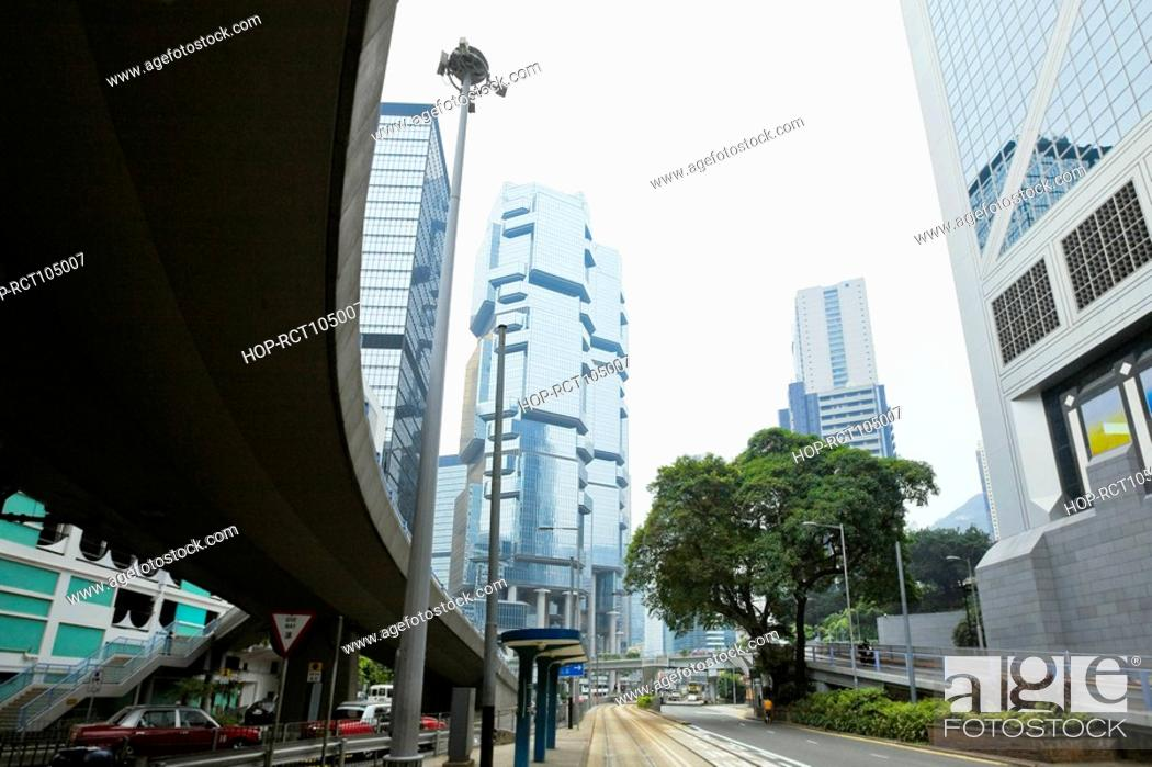 Stock Photo: Low angle view of skyscrapers in a city, Des Voeux Road, Hong Kong Island, China.