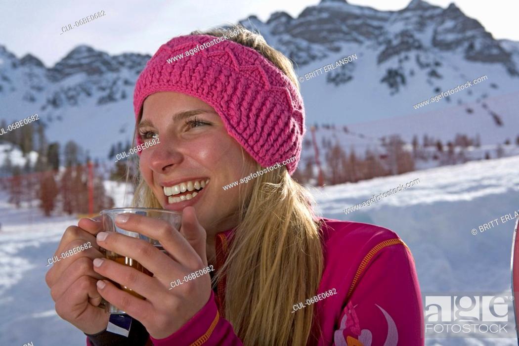 Stock Photo: Girl drinking, smiling.