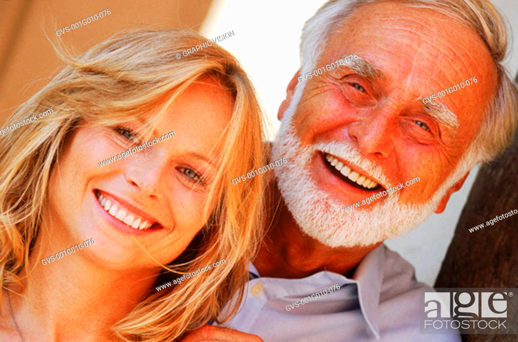 Stock Photo: Portrait of a senior man with a mid adult woman.