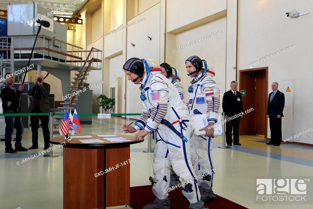 Stock Photo: At the Gagarin Cosmonaut Training Center in Star City, Russia, Expedition 4445 backup Flight Engineer Timothy Kopra of NASA signs in for the first of two days.