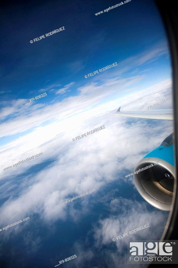 Stock Photo: Clouds through an airplane window.
