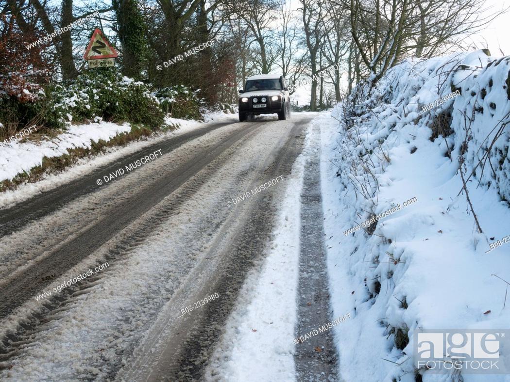 Stock Photo: country lane in snow, near Matlock, Derbyshire, Britain (December 2014).